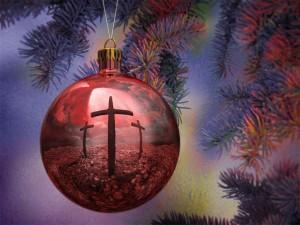 Picture of a red Christmas ornament with a cross see inside. What Christmas Eve means for us.