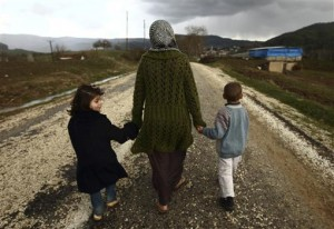 Sawssan Abdelwahab, who fled Idlib in Syria, walks with her children outside the refugees camp near the Turkish-Syrian border in the southeastern city of Yayladagi February 16, 2012. REUTERS/Zohra Bensemra (TURKEY - Tags: CIVIL UNREST POLITICS)