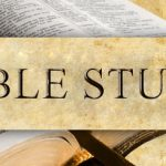 An open bible with the words Bible Study on top.