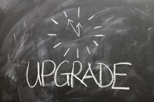 the word upgrade written on a chalk board